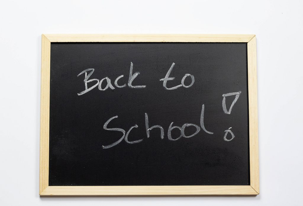 Back to school written on a black chalkboard
