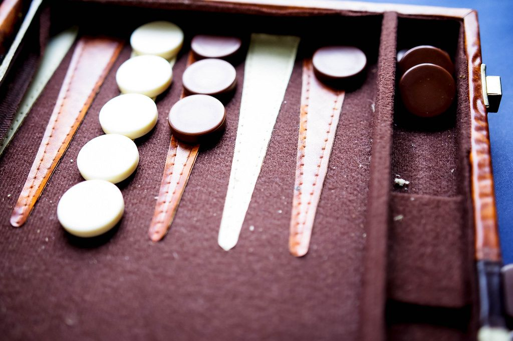 Backgammon game tokens on game board