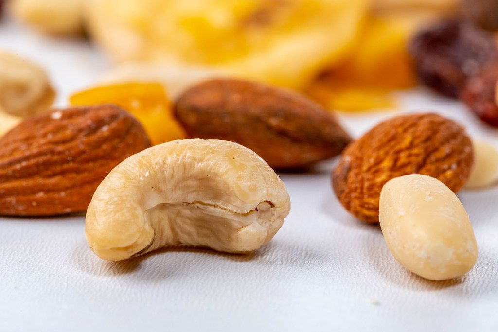 Background of mixed nuts - cashew, peanuts and almonds