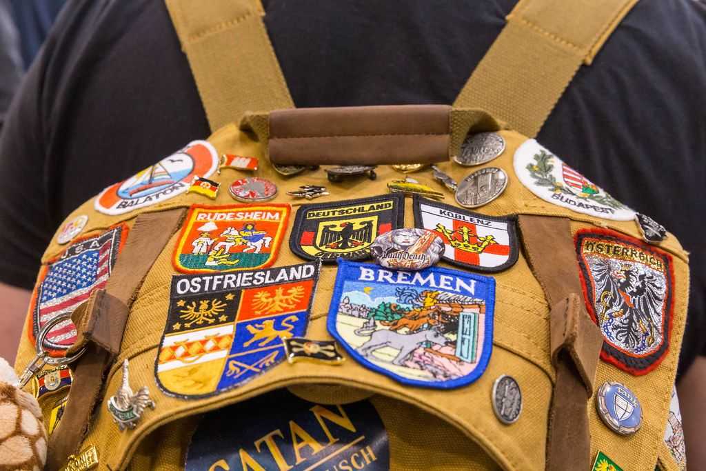 Backpack with different patches of cities and countries