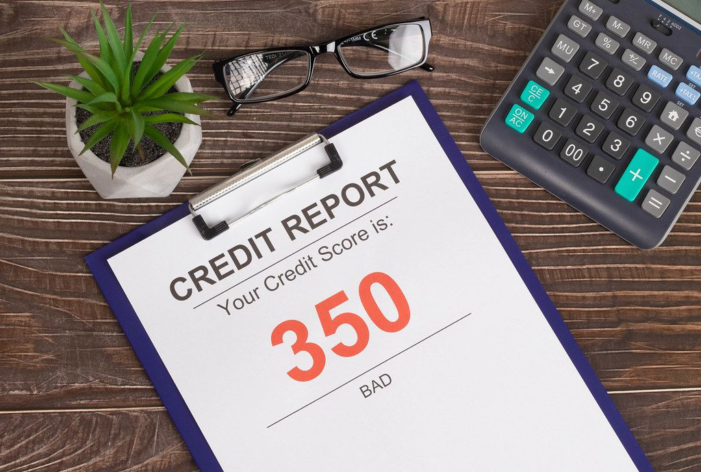 Bad credit score report of 350 on wooden table