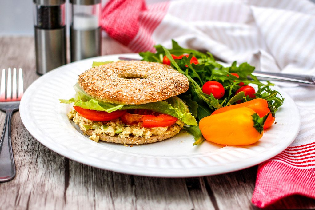 Bagel Egg Salad with pepper and salad
