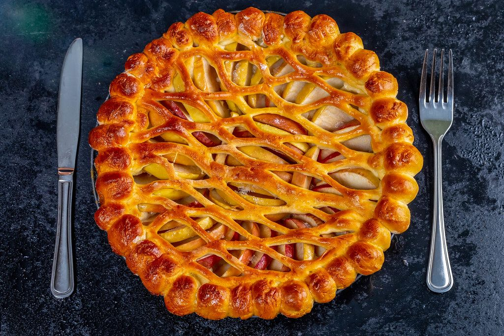 Baked Apple pie with knife and fork. Top view (Flip 2019)