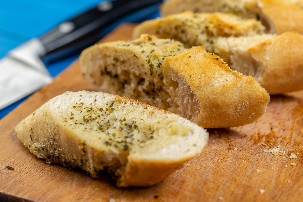Baked Bread Bruschetta on the cutting board (Flip 2019)