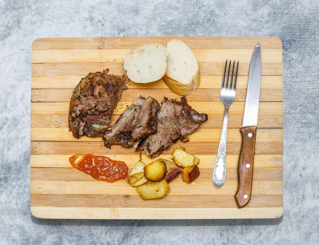 Baked meat on wooden board