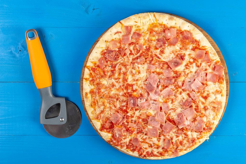 Baked Pizza with Ham and pizza round knife
