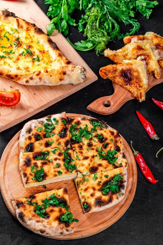 Baking background with three kinds of khachapuri - meat, cheese and Adygei khachapuri