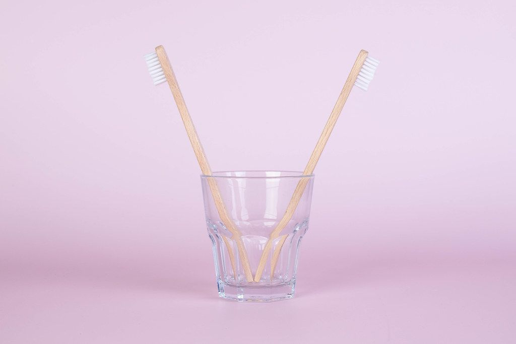 Bamboo toothbrushes in a glass