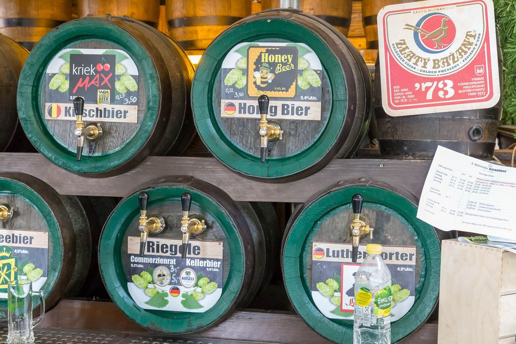 Barrels with different types of beer