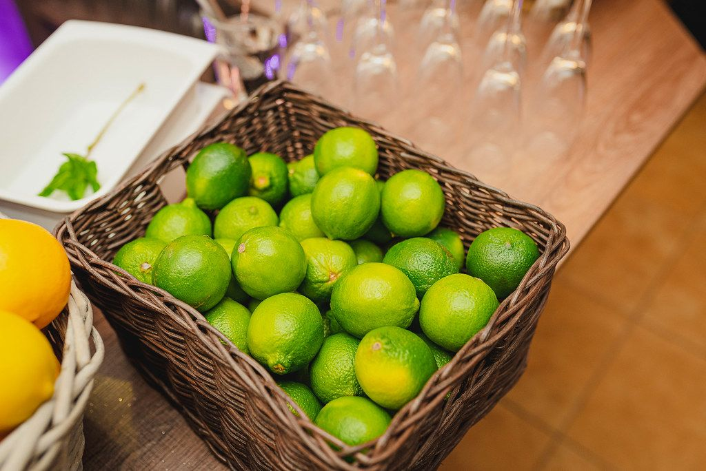 Basket Of Limes On The Table