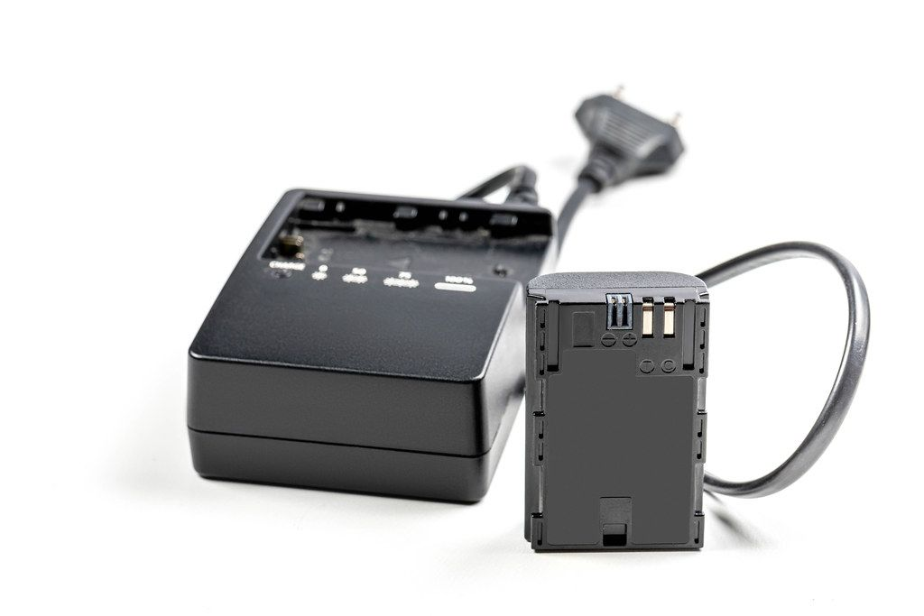 Battery to camera with charger on white background