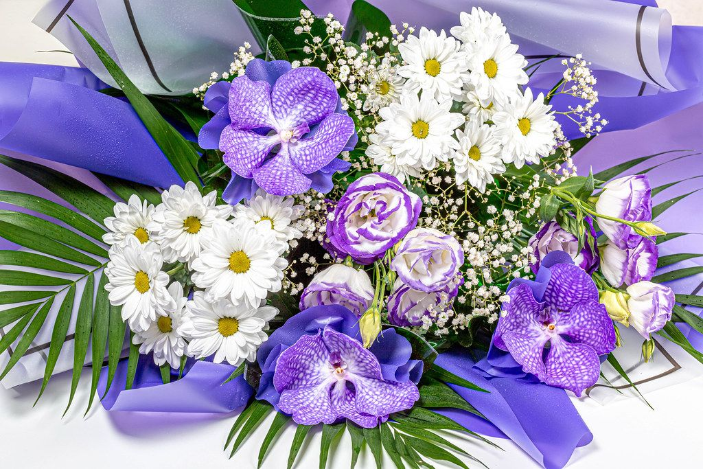 Beautiful bouquet of flowers with purple orchids and white chrysanthemums