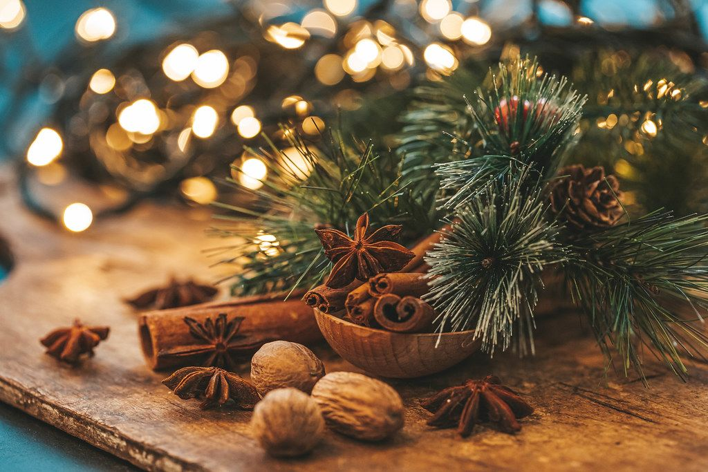 Beautiful Christmas background with spices and blurred glow garland (Flip 2019)