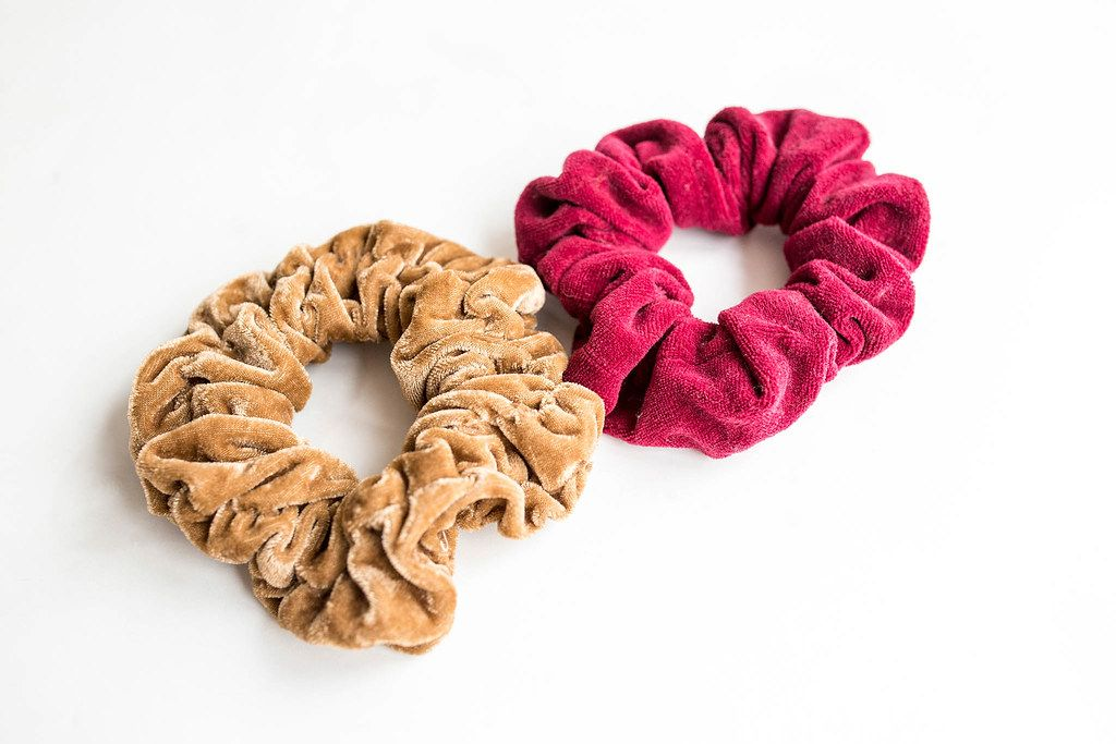 Beige and red scrunchies on white background
