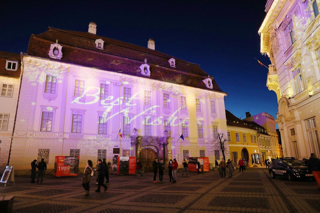 Best Wishes message, light reflection on buildings for Christmas holidays, Sibiu