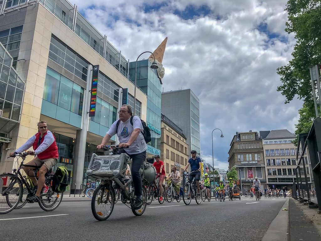 Bicycle demonstration Critical Mass focusses on environment and mobility while driving through the big city with music system as bicycle traffic