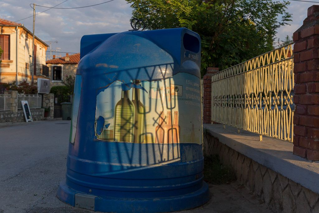 Big blue recycle bin for glass. Waste separation in Greece