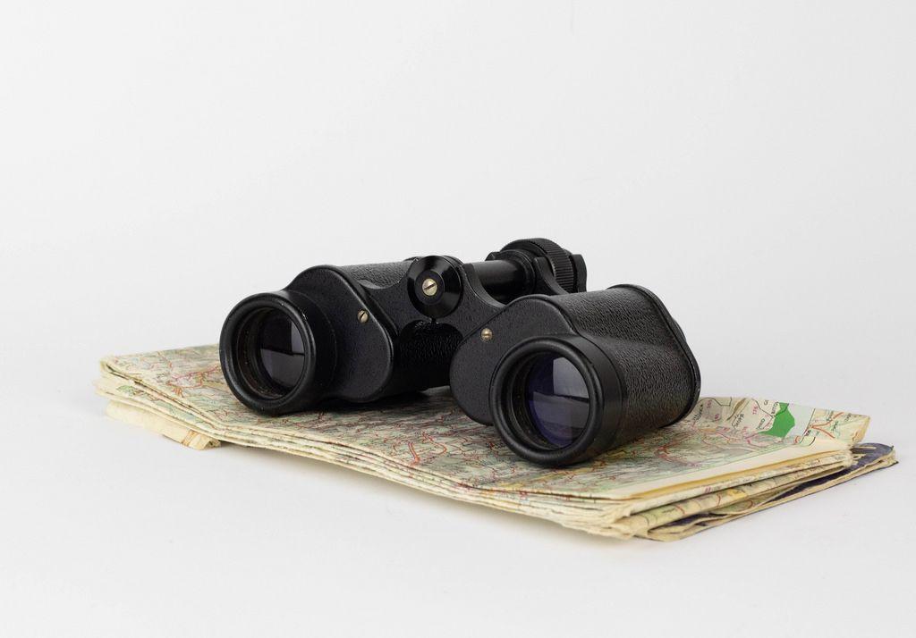 Binoculars on the old map