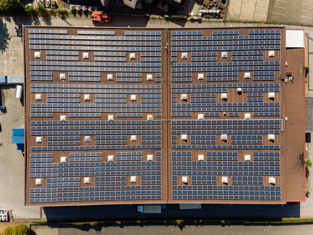 Bird's eye view of solar panels on the roof of an industrial building