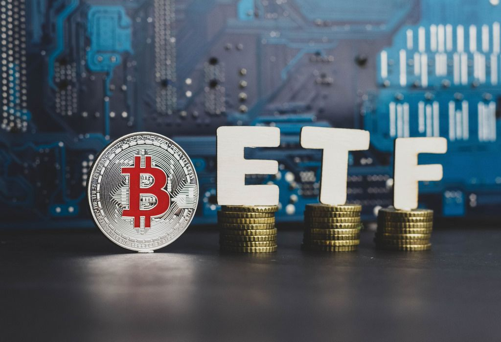 Bitcoin coin with ETF text, concept entering the digital money fund