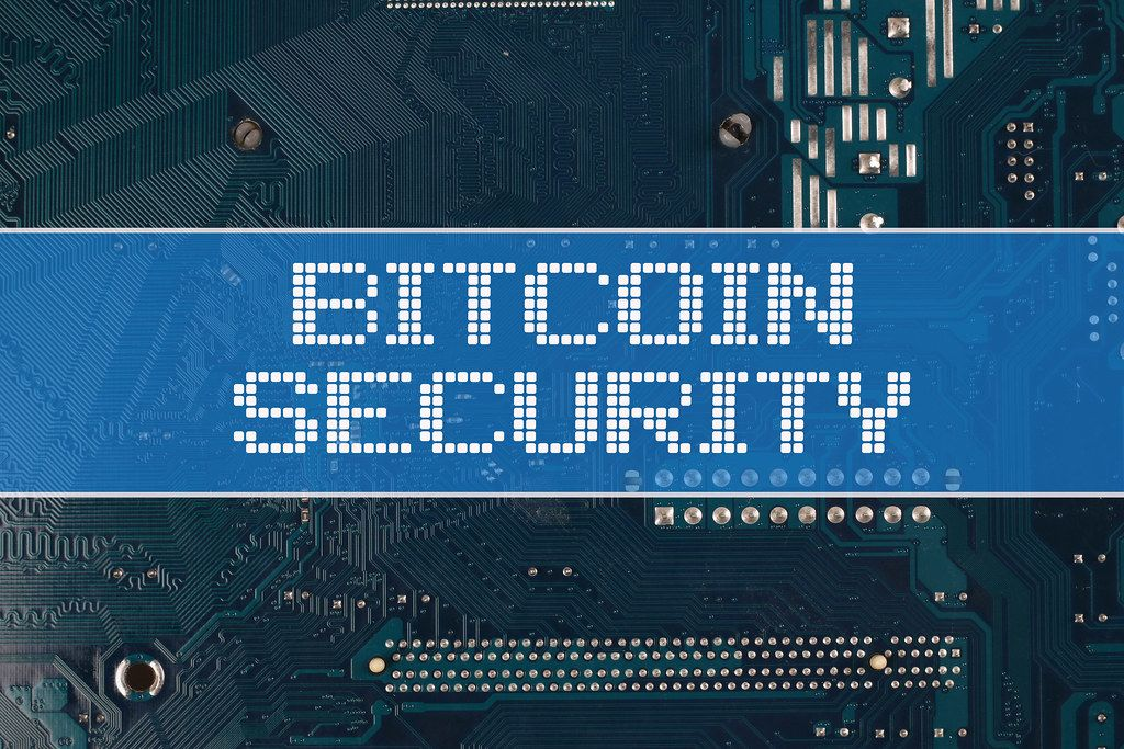 Bitcoin Security text over electronic circuit board background
