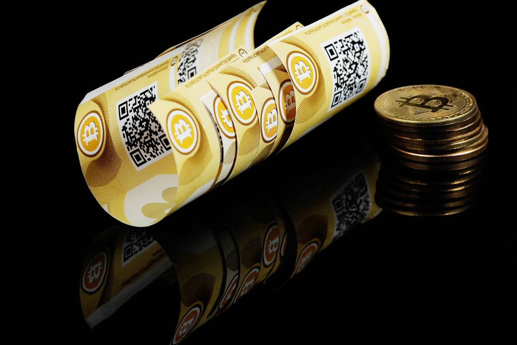 Bitcoins banknotes and coins, virtual money