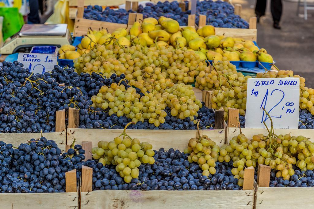 Black and white grapes on marketplace