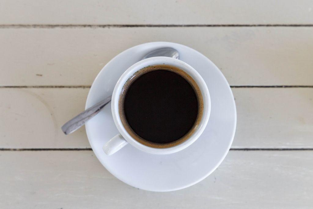 Black coffee (americano) on wooden  background (Flip 2019) (Flip 2019) Flip 2019