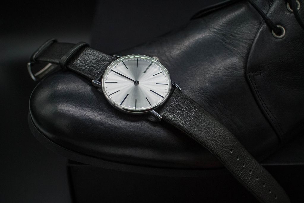 Black leather shoes and wrist watch. Formal dress code