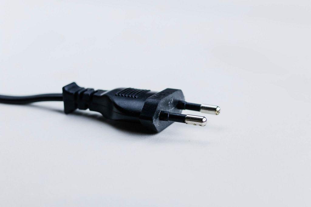 Black plug on white background