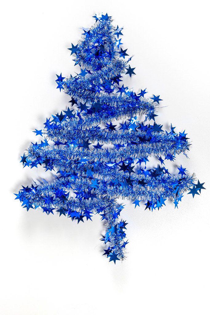 Blue christmas tree on white background