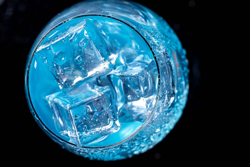 Blue cocktail with ice cubes. Top view (Flip 2019)