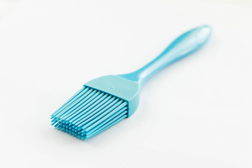 Blue cooking brushing tool, close up