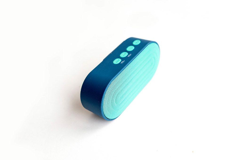 Blue portable mini speaker on white background