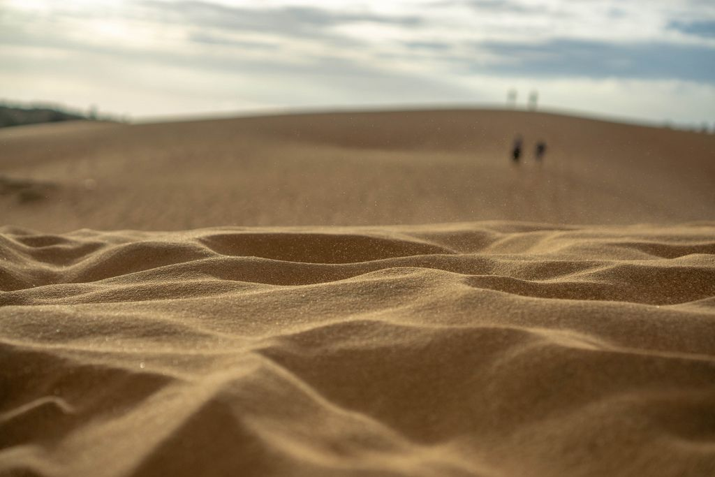 Bokeh Photo of the Red Sand Dunes in Mui Ne with Sunset in the Background