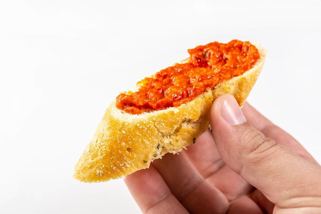 Bread Baguettes with Tomato and Tartar Sauce in the hand (Flip 2019)