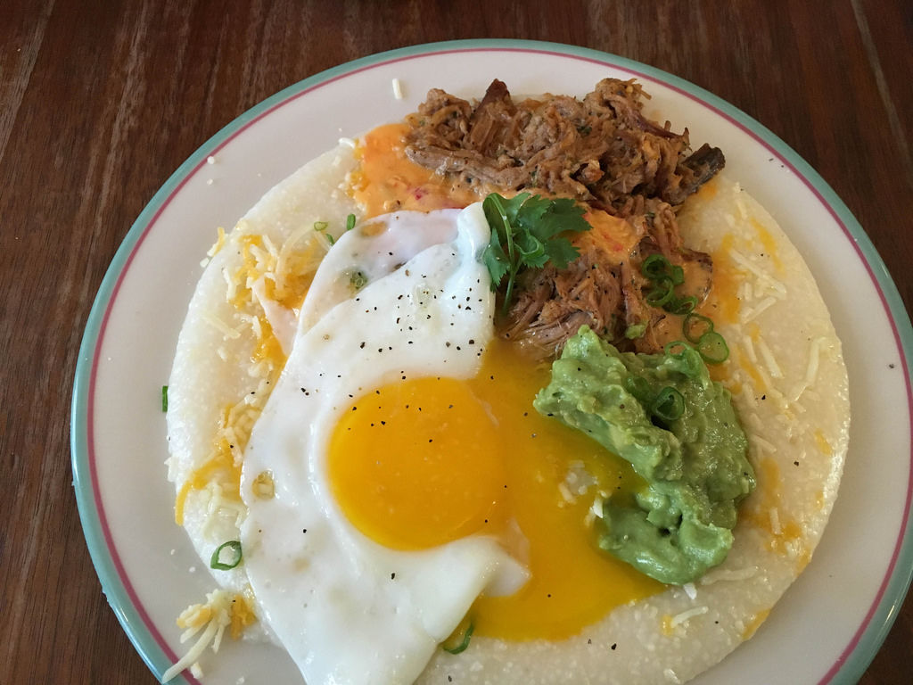 Breakfast: Avocado creme, Pulled Pork and Fried Egg