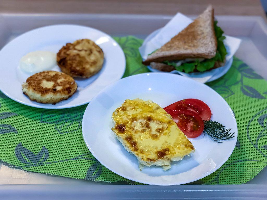 Breakfast: Sandwich, eggs and Russian pancakes