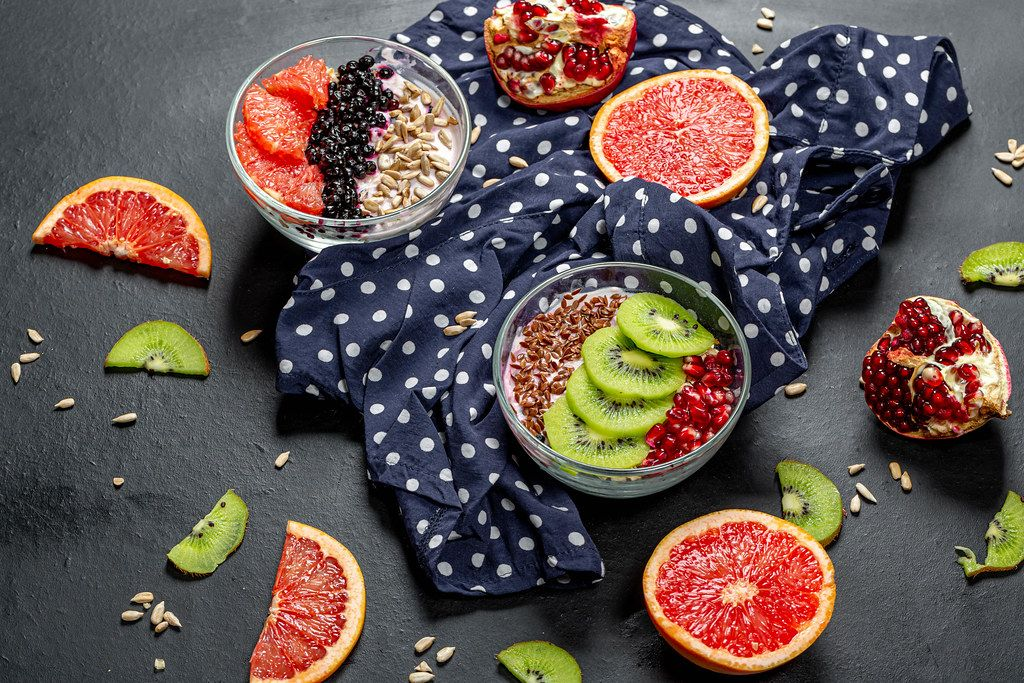 Breakfast with fresh fruit, oatmeal and seeds. Top view