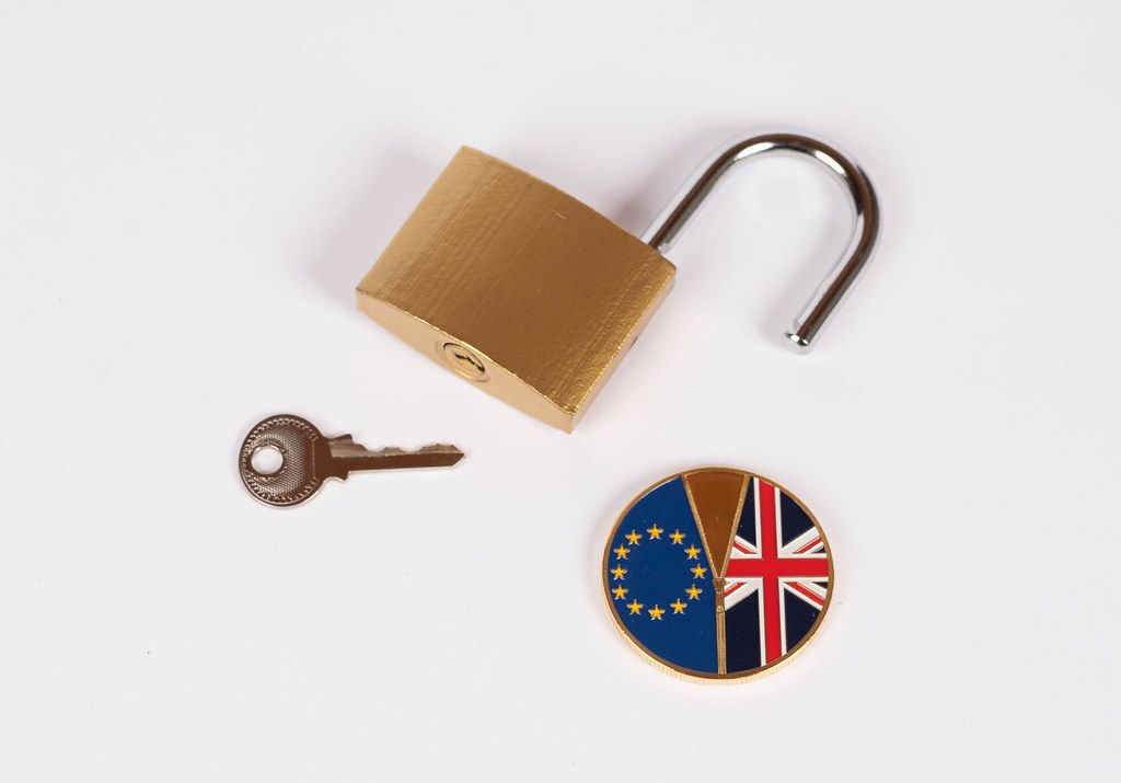 Brexit medal coin with open padlock and key on white background (Flip 2019)