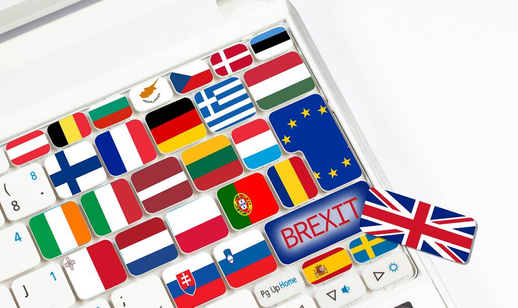 Brexit text and international flags on computer keyboard
