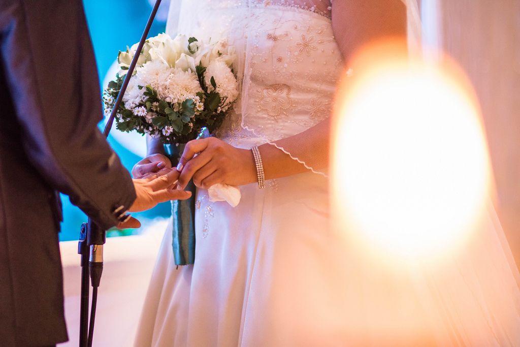 Bride inserting wedding ring to Groom's finger (Flip 2019) (Flip 2019) Flip 2019