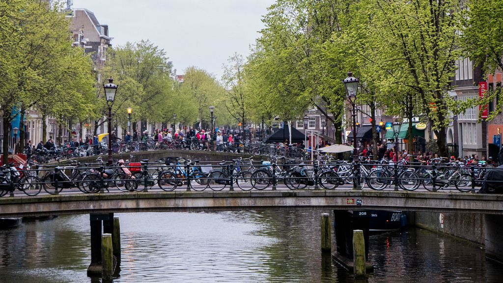 Bridges full of bicycles and people crossing in the red light district in Amsterdam