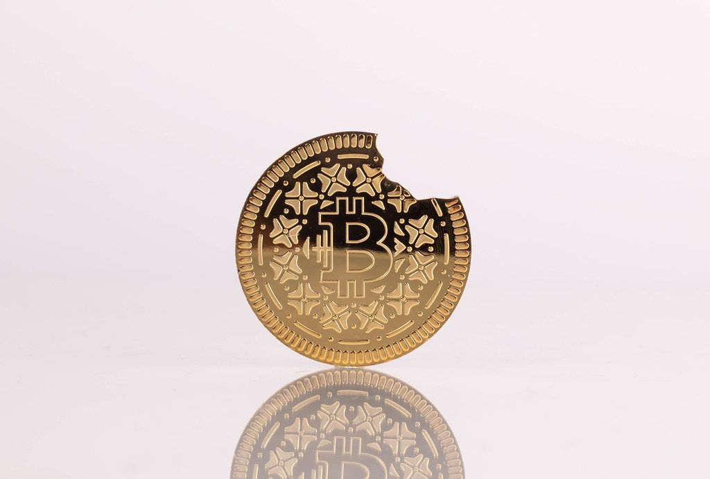 Broken Bitcoin on white background