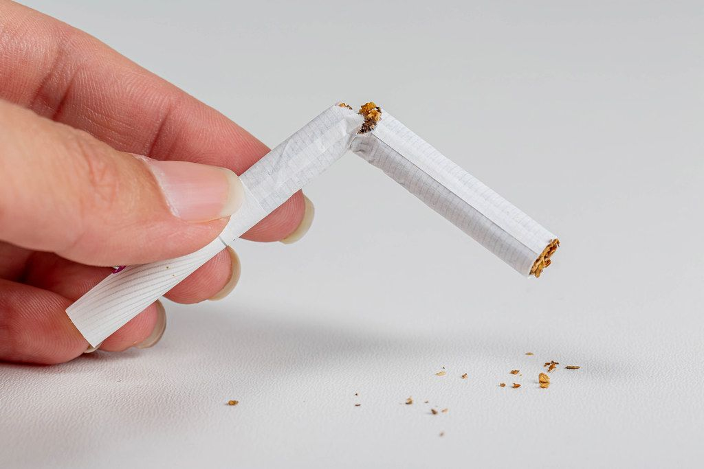 Broken cigarette on white background. World no tobacco day and lung health concept