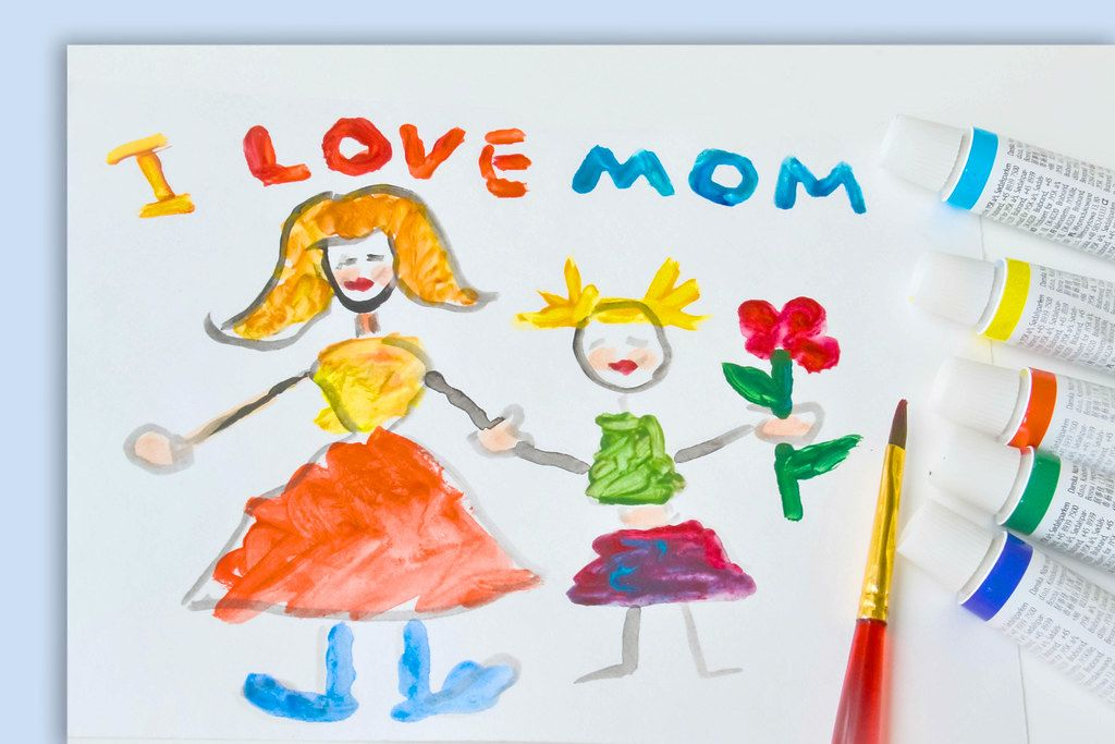 Brush and Paint on a Child Painting saying I Love Mom