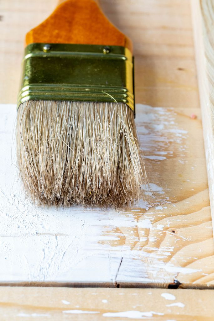 Brush for paint lies on being redecorated boards