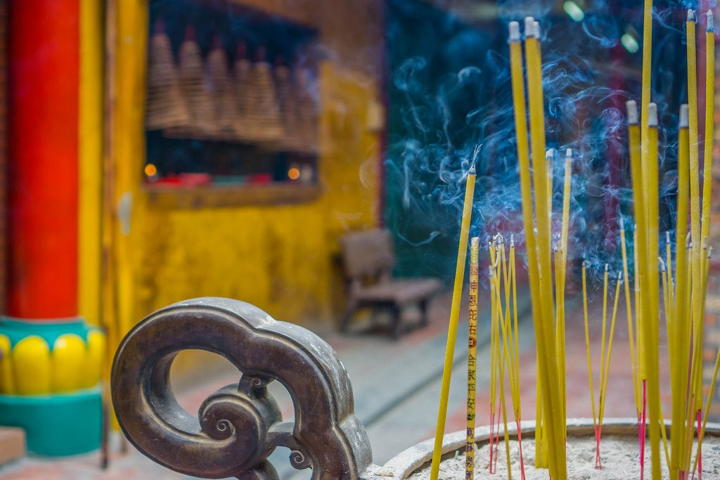 Burning Incense Sticks in a Sand Box at a local Pagoda in Ho Chi Minh City