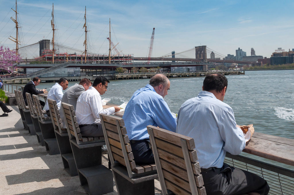 Business Men having Lunch at Pier 15, East River Esplanade New York