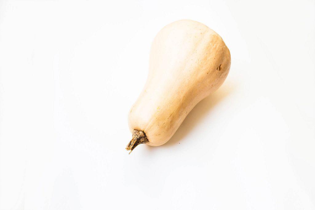 Butternut squash isolated on white background (Flip 2019) (Flip 2019) Flip 2019